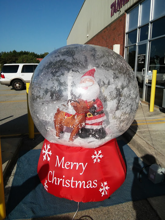 Inflatable photorealistic snow globe with santa and